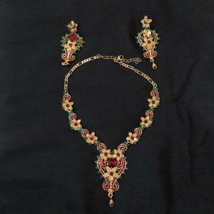 Gold, red and green necklaces and earrings